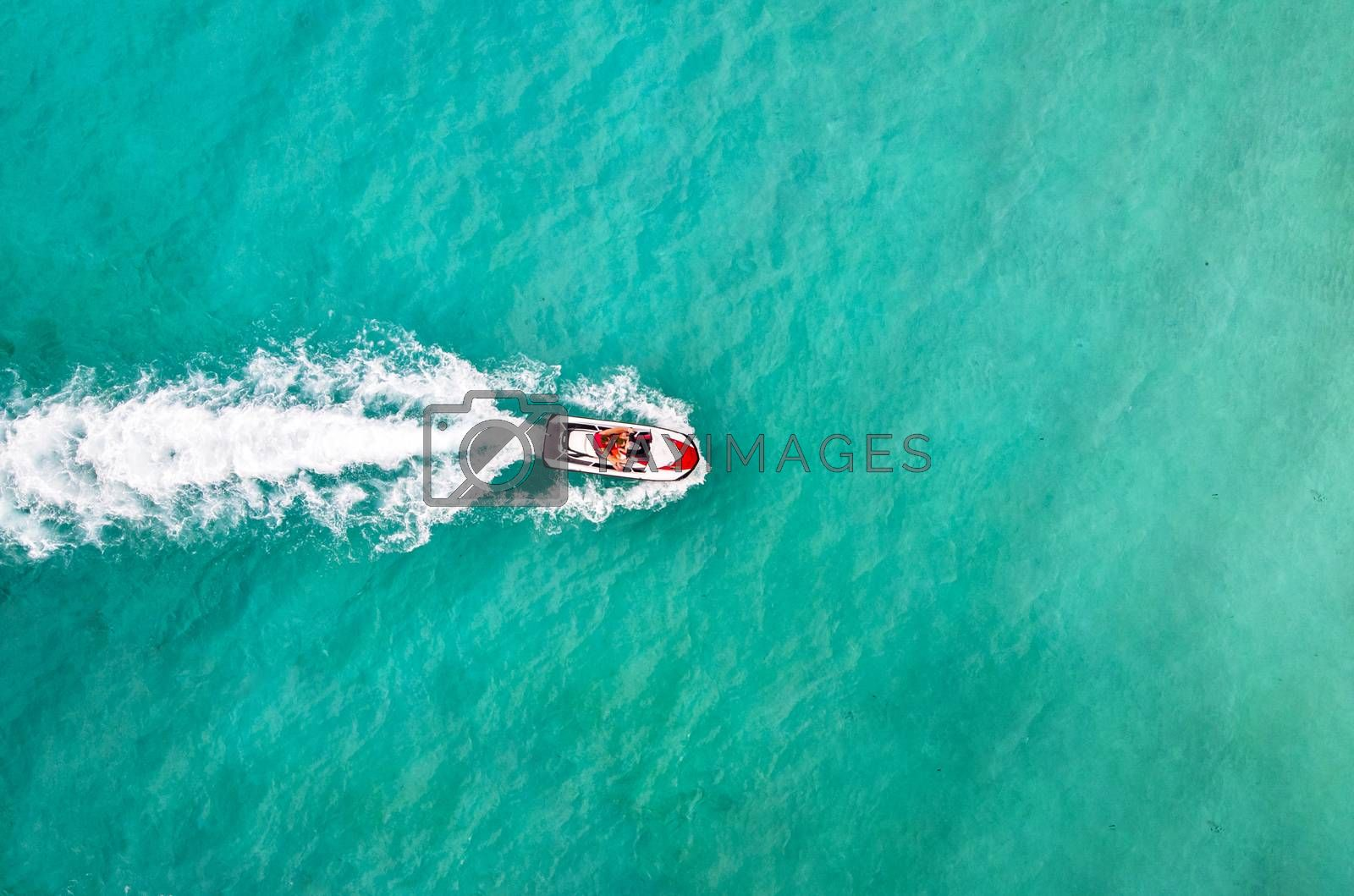 Royalty free image of Beautiful Aerial View jet ski in sea. Entertainment on water bikes in sea turquoise water. Tourists have fun on vacation. Aerial Top view. People are playing a jet ski. amazing nature background by diy13