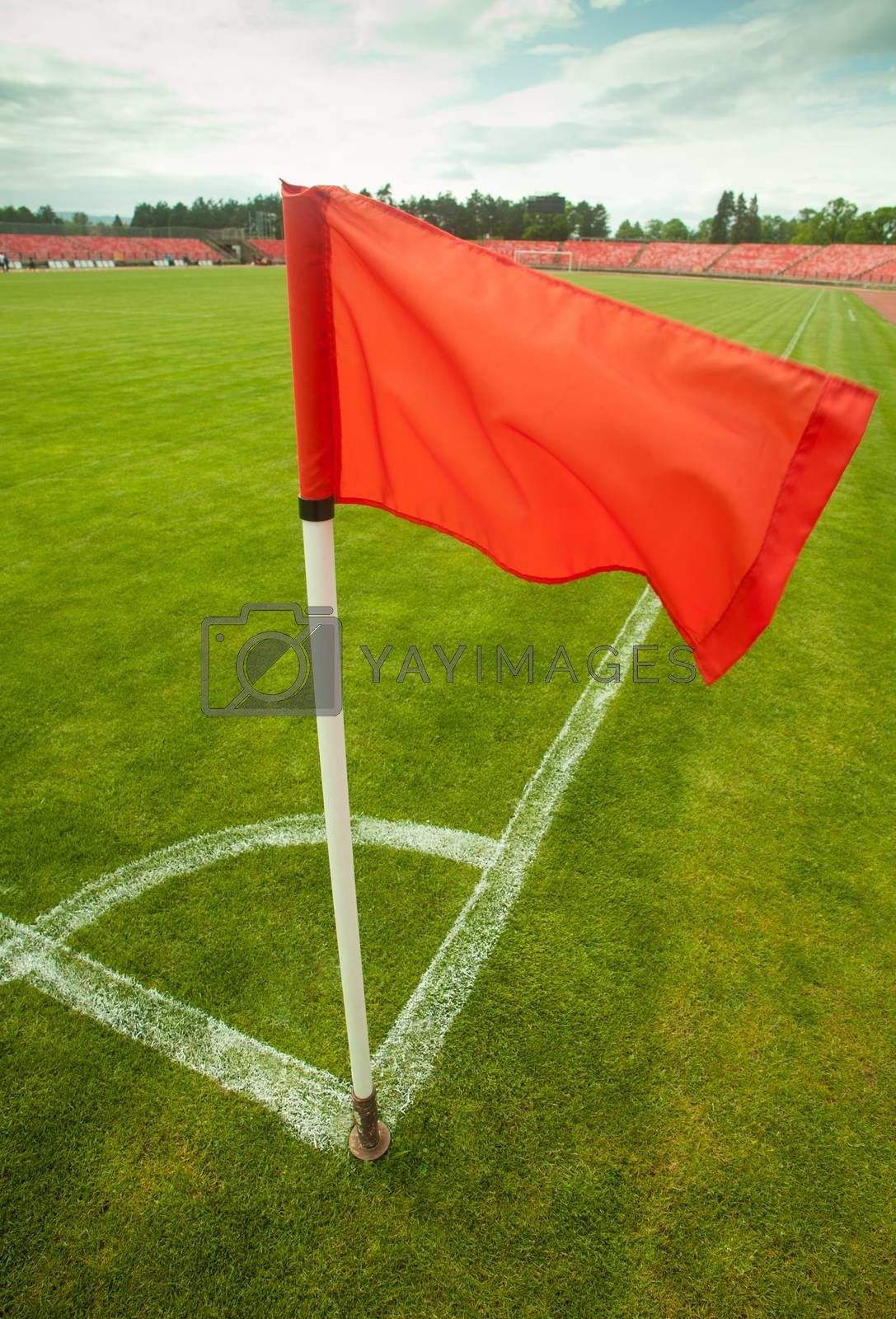 Royalty free image of red corner flag by IxMaster