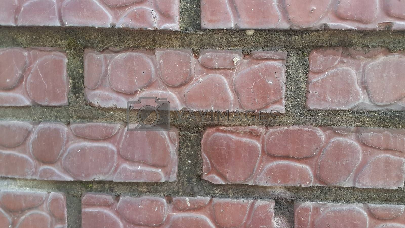 Royalty free image of A background of a weathered old exterior brick wall in the sunshine. by Photochowk