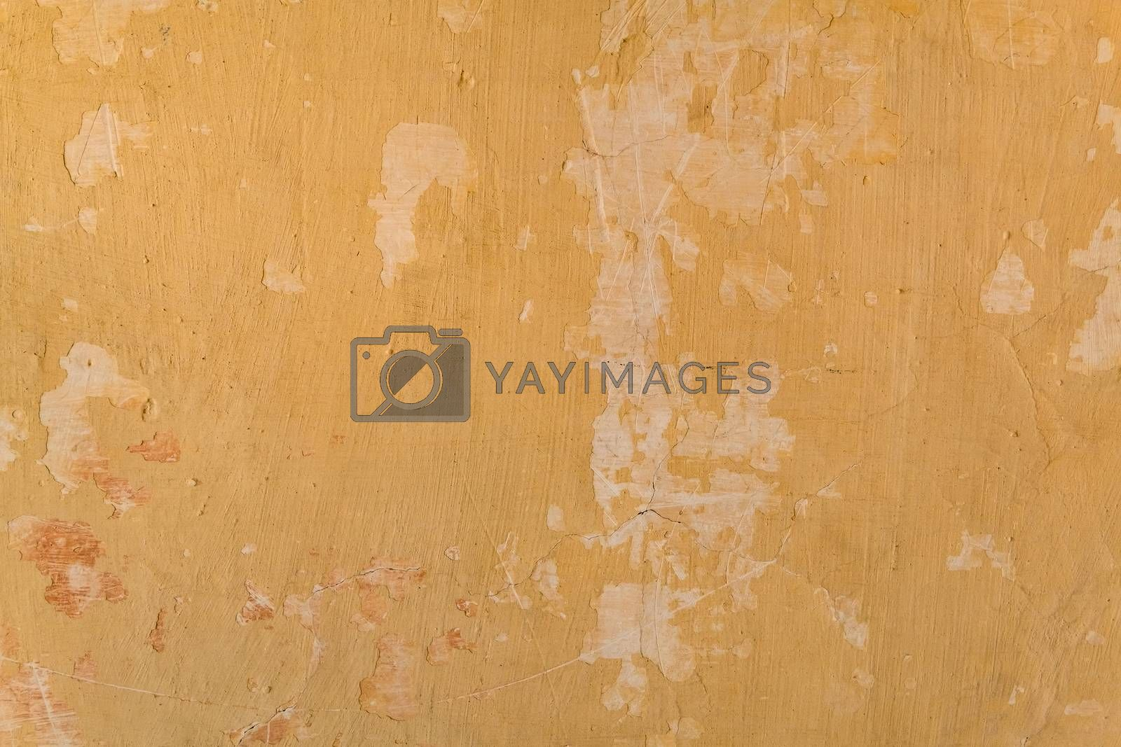 Royalty free image of Paint crack concrete wall texture background. by Tanarch