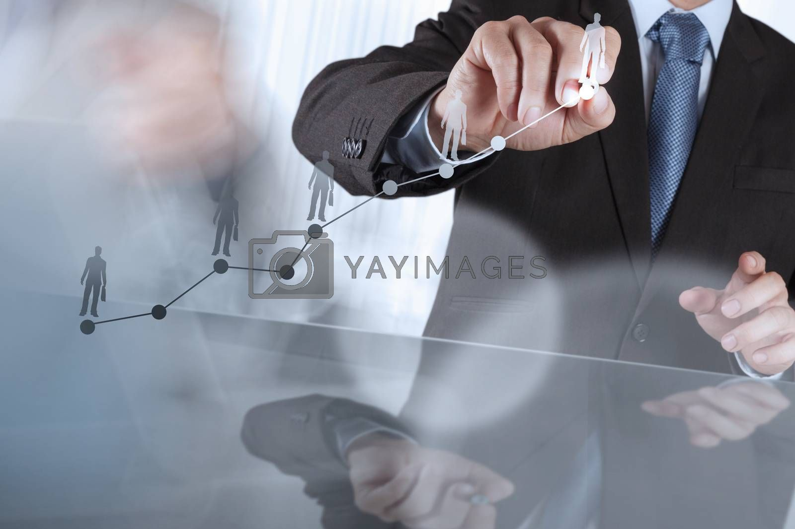 Royalty free image of businessman hand working with new modern computer and business s by everythingpossible