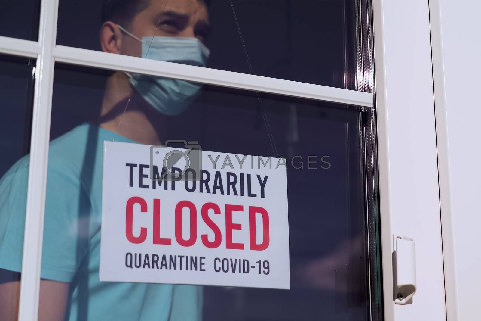 Royalty free image of TEMPORARILY CLOSED sign on a door shop, restourant by Sid10