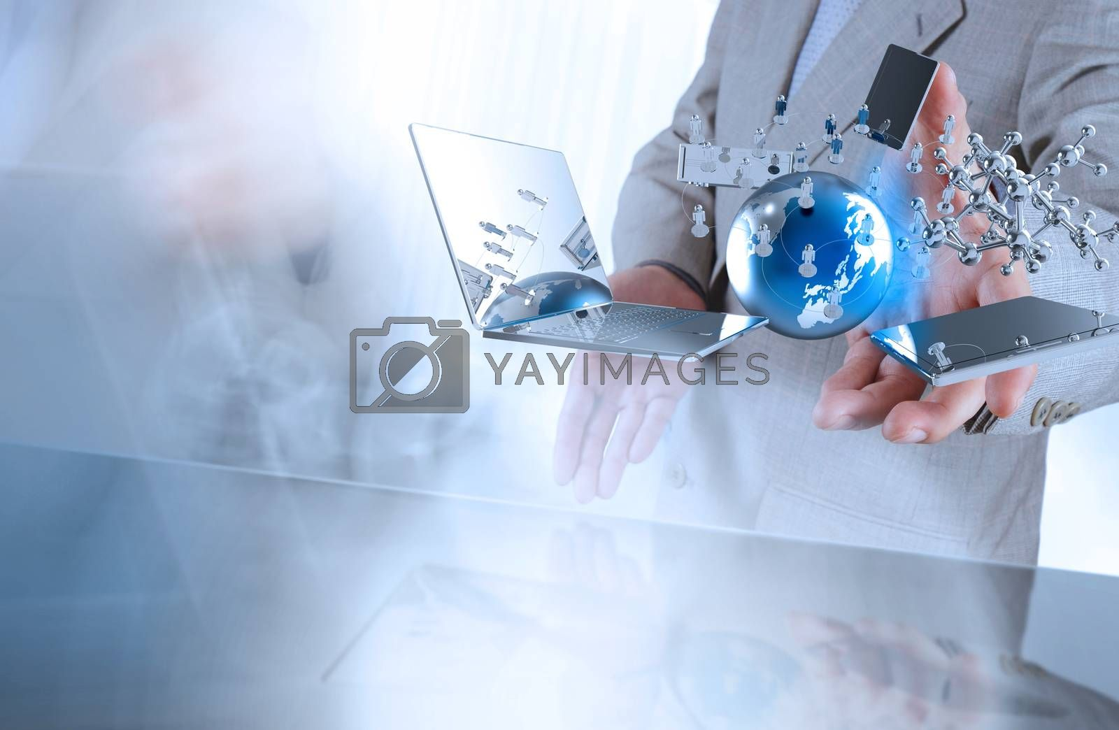 Royalty free image of businessman shows modern technology as concept  by everythingpossible