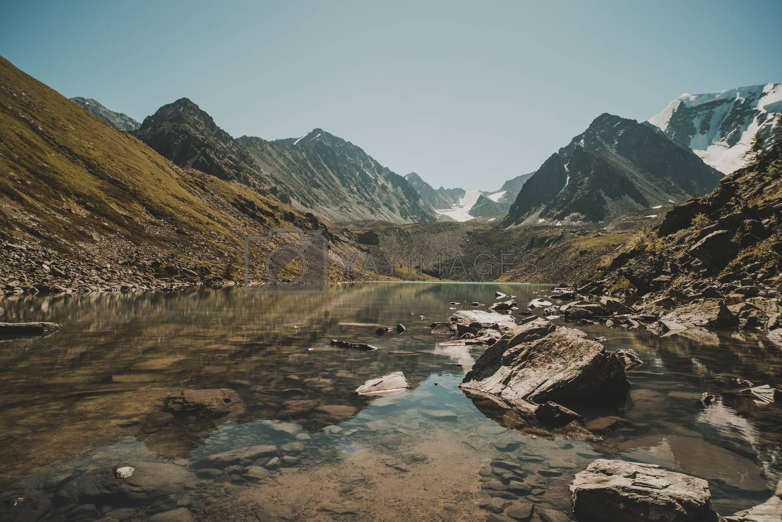 Royalty free image of Altai forest reflect on the lake. beautiful landscape in morning time with warm tone. Beautiful calm landscape in the mountains without people. Wildlife in Siberia. Russia by diy13