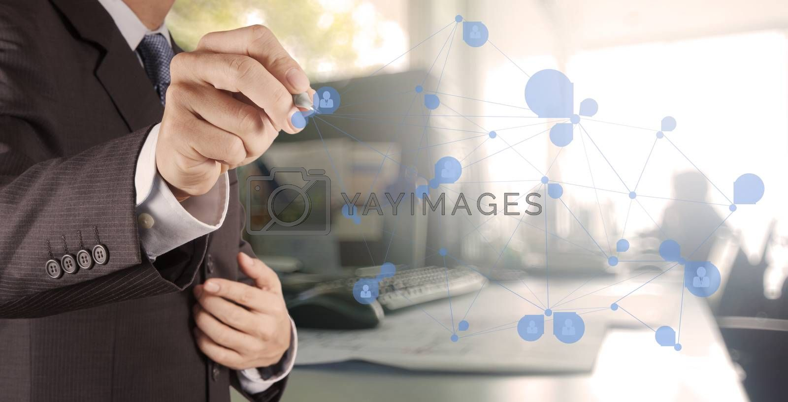 Royalty free image of businessman working with new modern computer show social network by everythingpossible