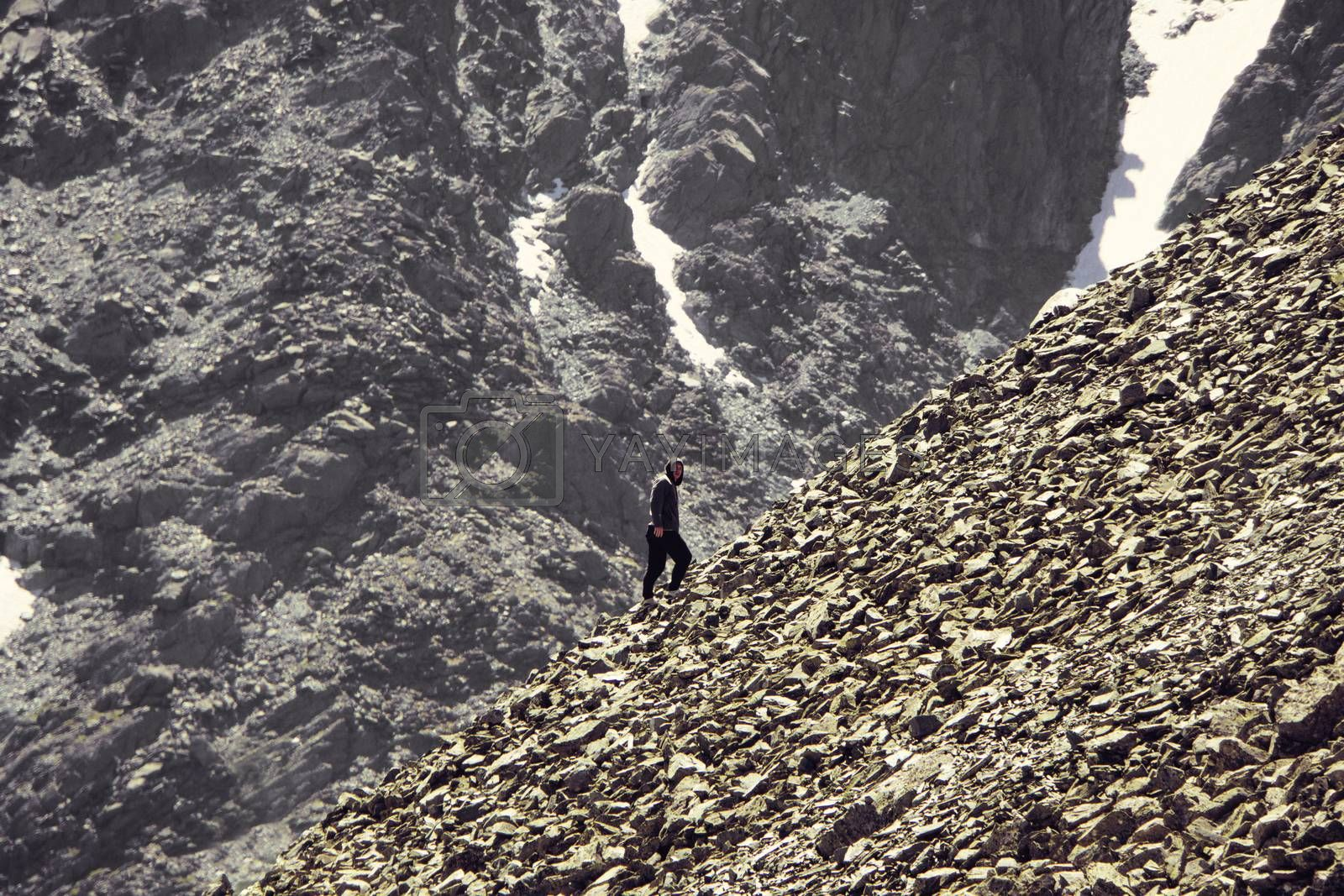 Royalty free image of man climbing steep mountain. Good image for adventure, struggle and success story photo. by diy13