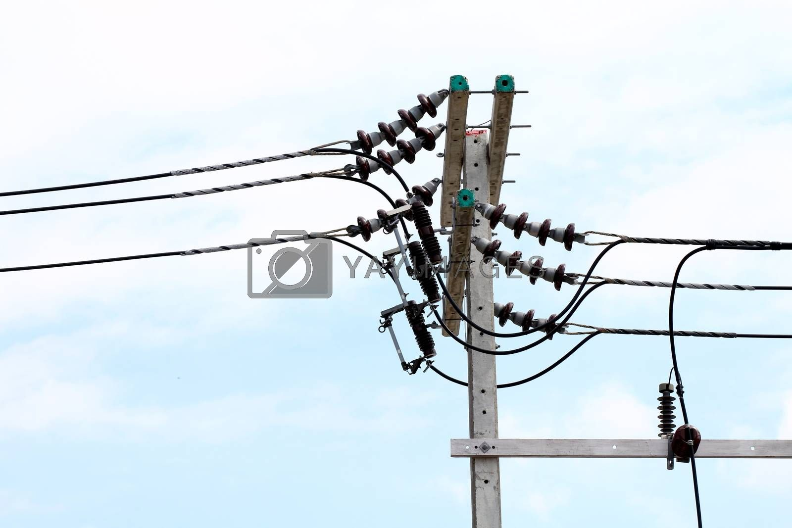 Royalty free image of Electric pole power Tangle wire danger, wire electrical energy at street road on sky background by cgdeaw