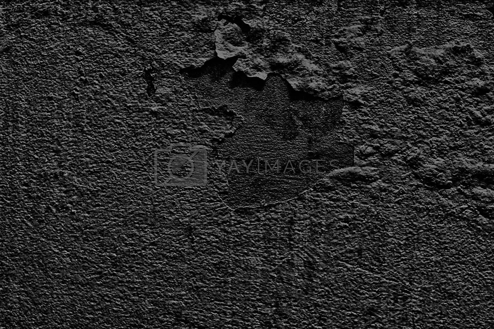 Royalty free image of Black color Paint peeling cuticles on textured Wall plaster Siemens, Background Cracked walls inbreeding, Abstract wall Black background texture by cgdeaw