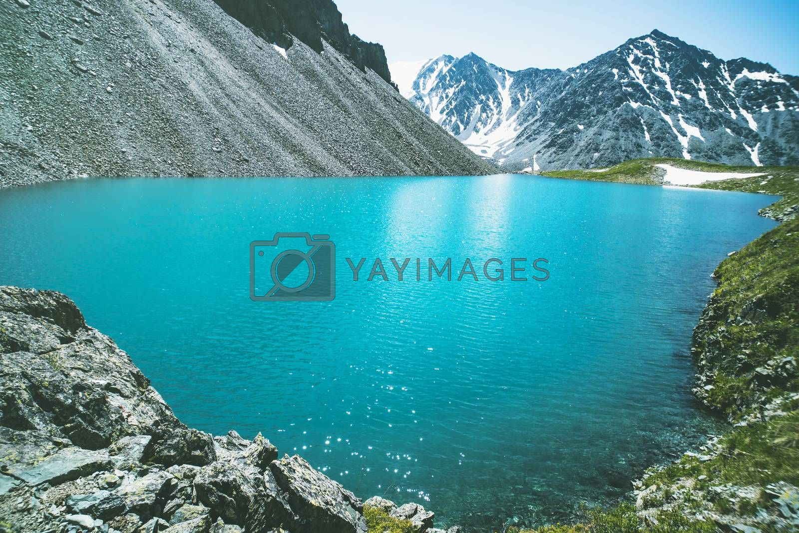 Royalty free image of Beautiful mountain lake with turquoise clear water in the Altai Republic Siberia Russia. Pure blue water in a deep lake surrounded by mountains by diy13