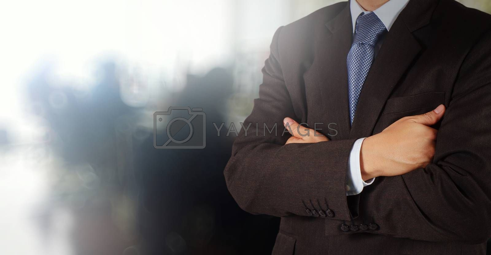Royalty free image of businessman success with his office  background as concept by everythingpossible