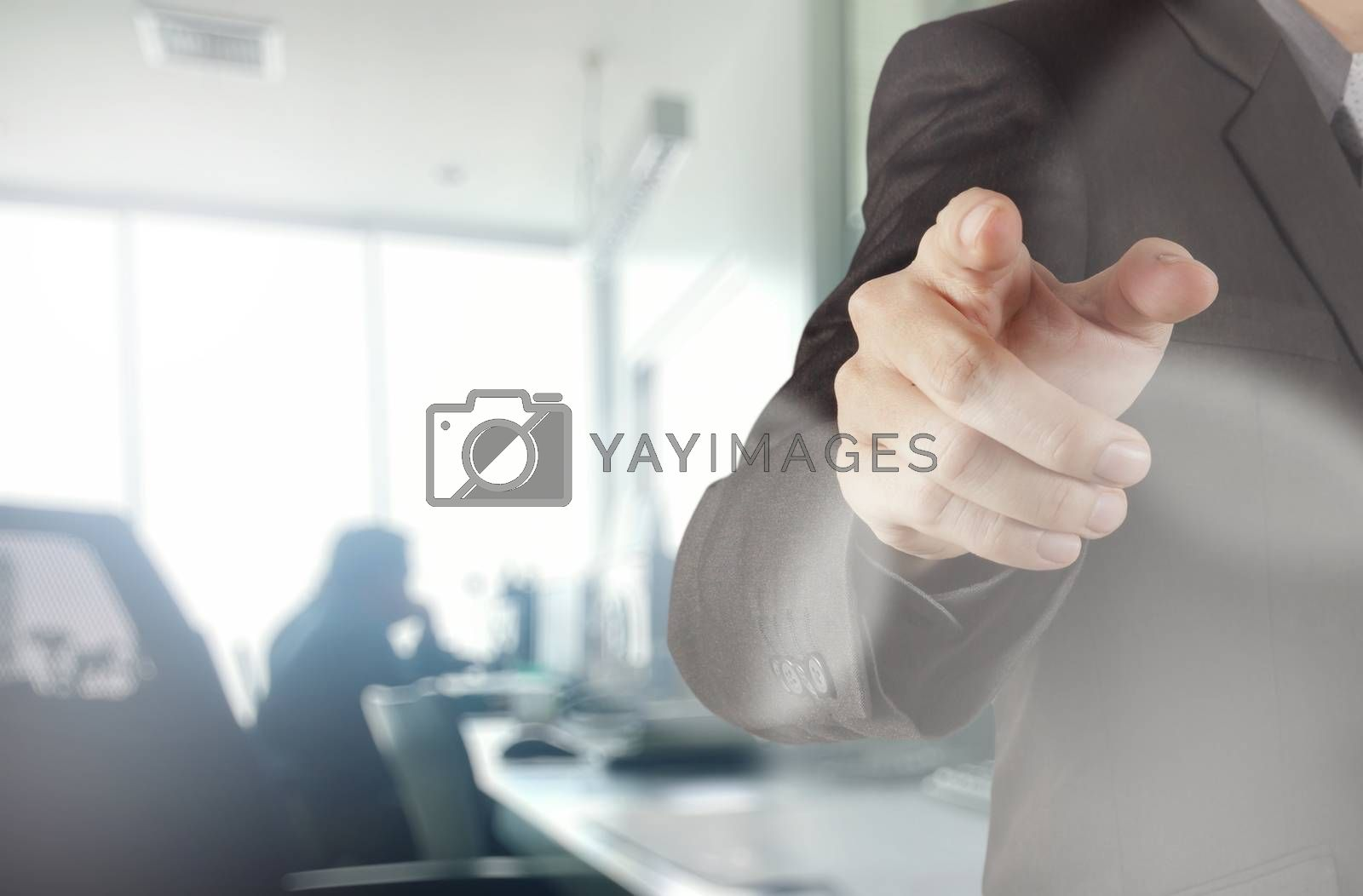 Royalty free image of businessman working with his office  background as concept by everythingpossible