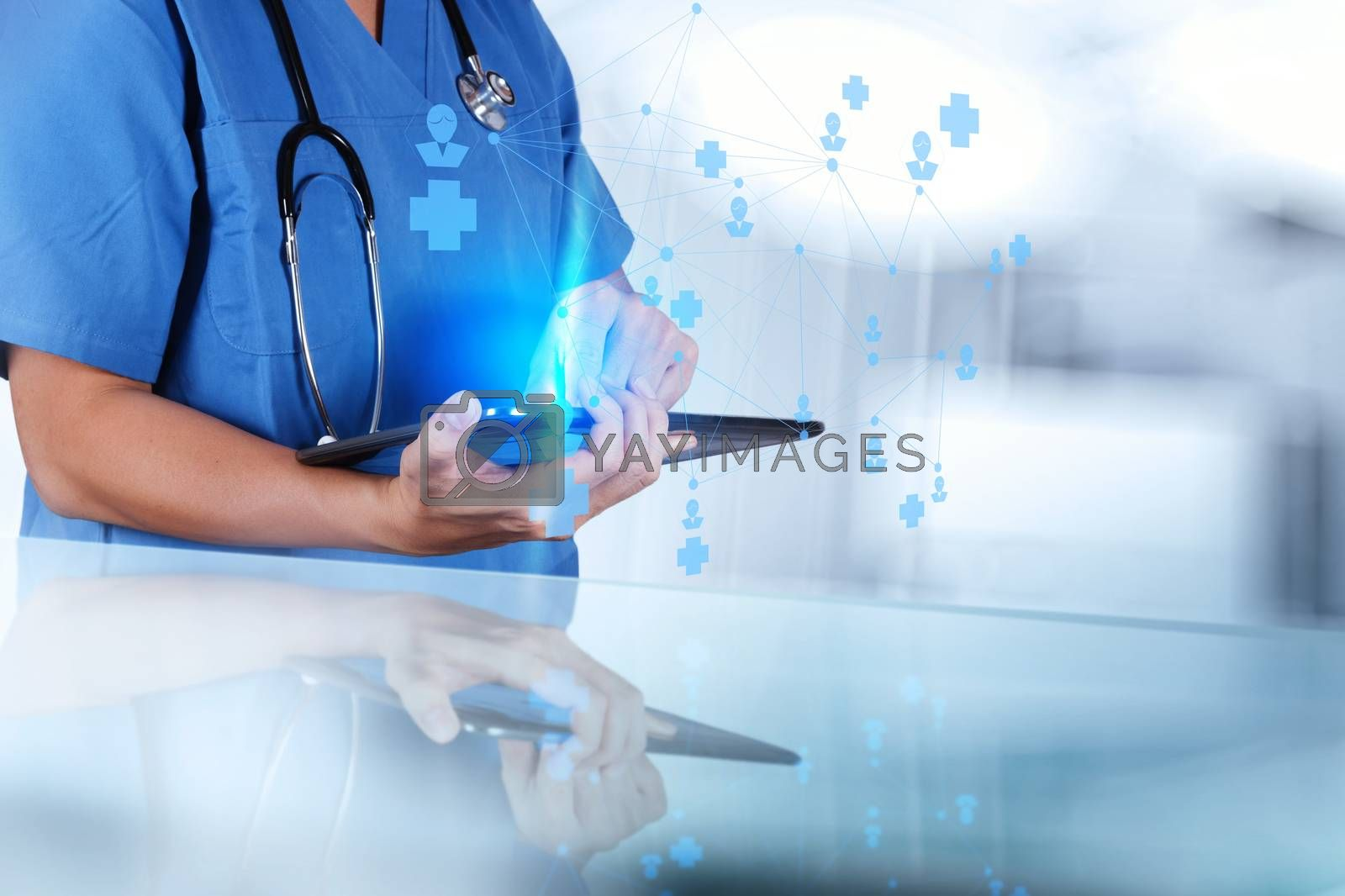 Royalty free image of smart medical doctor hand showing network with operating room as by everythingpossible