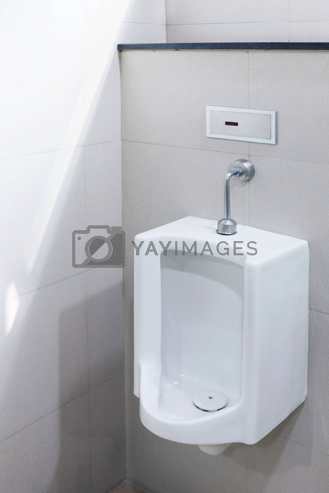 Royalty free image of Urinals for men outdoor toilet, Urinals white ceramic at bathroom public, close-up white urinals by cgdeaw