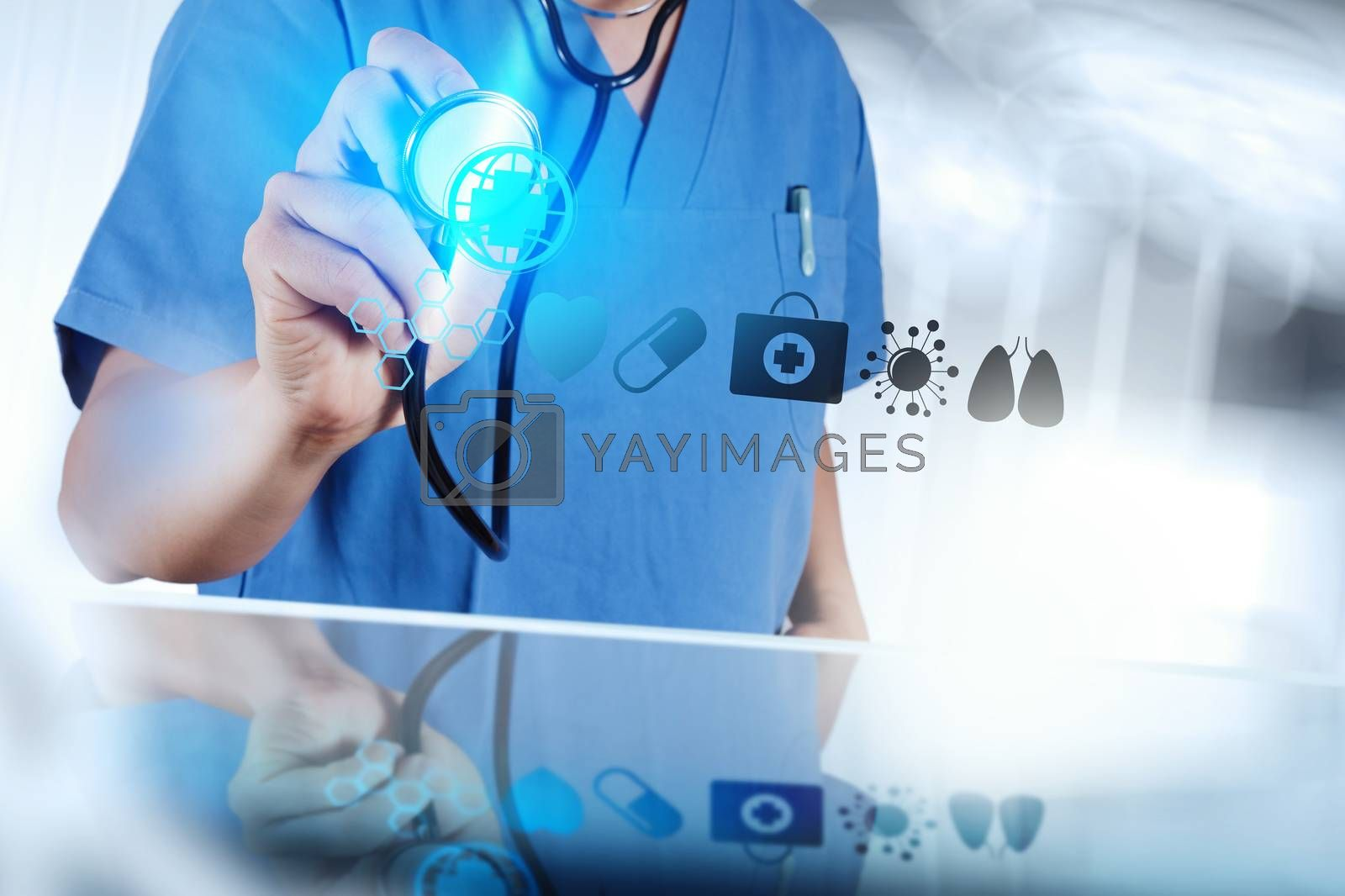Royalty free image of Medicine doctor hand working with modern computer interface as m by everythingpossible