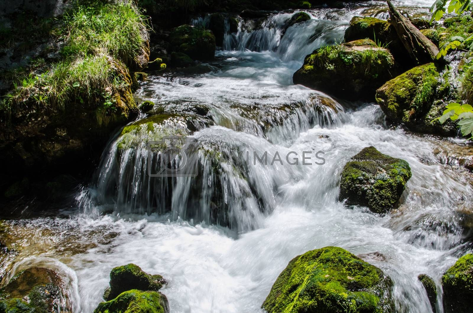 Royalty free image of water and rocks in the brook by thomaseder