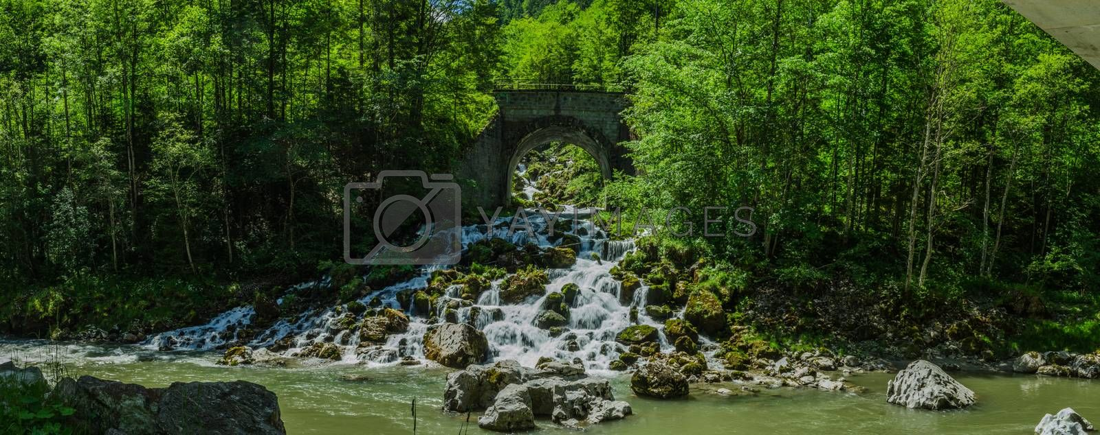 Waterfall with bridge panorama view