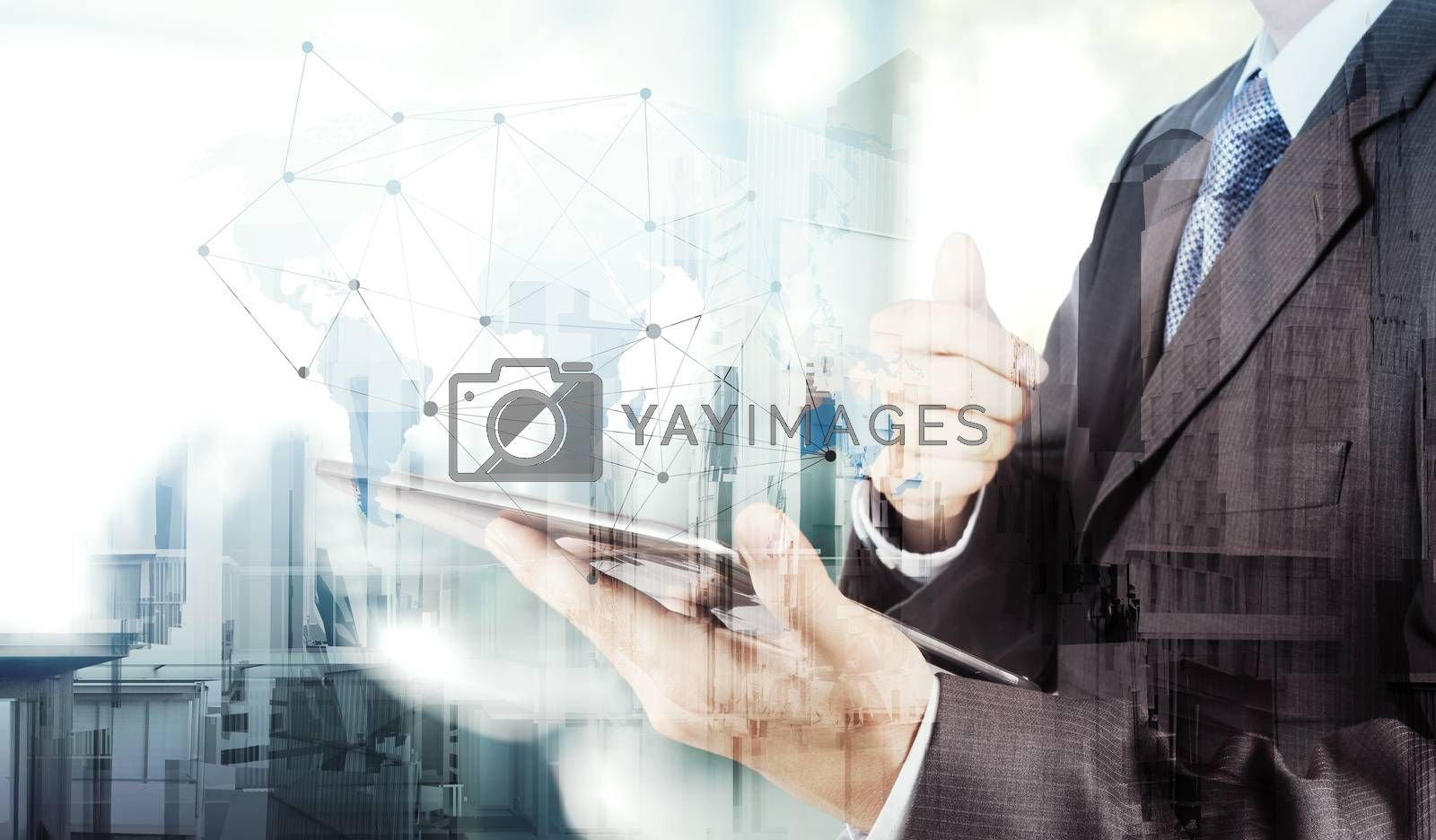 Royalty free image of Double exposure of businessman working with new modern computer  by everythingpossible
