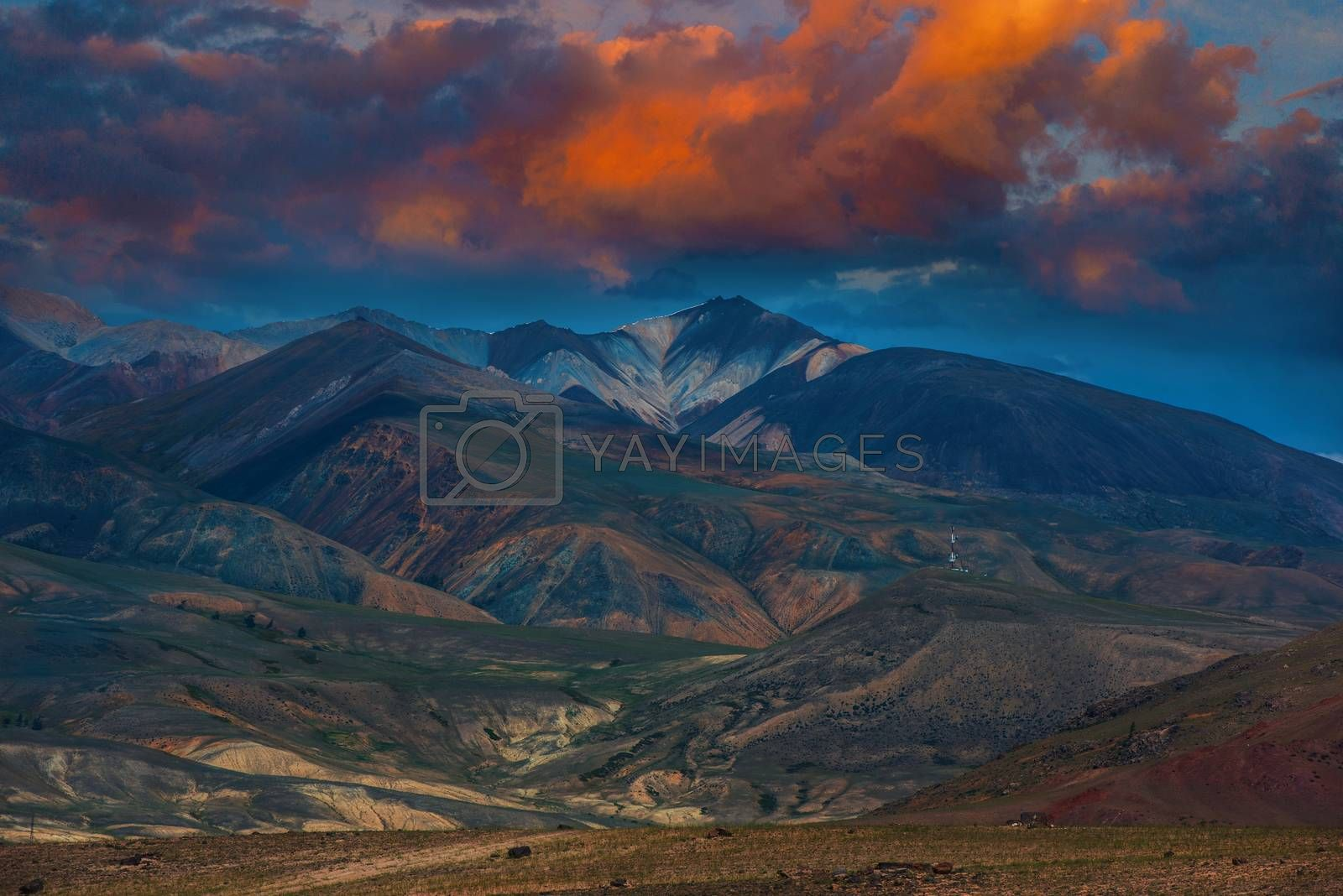 Different colored mountains with beauty sunset sky in Mongolian Altai mountains