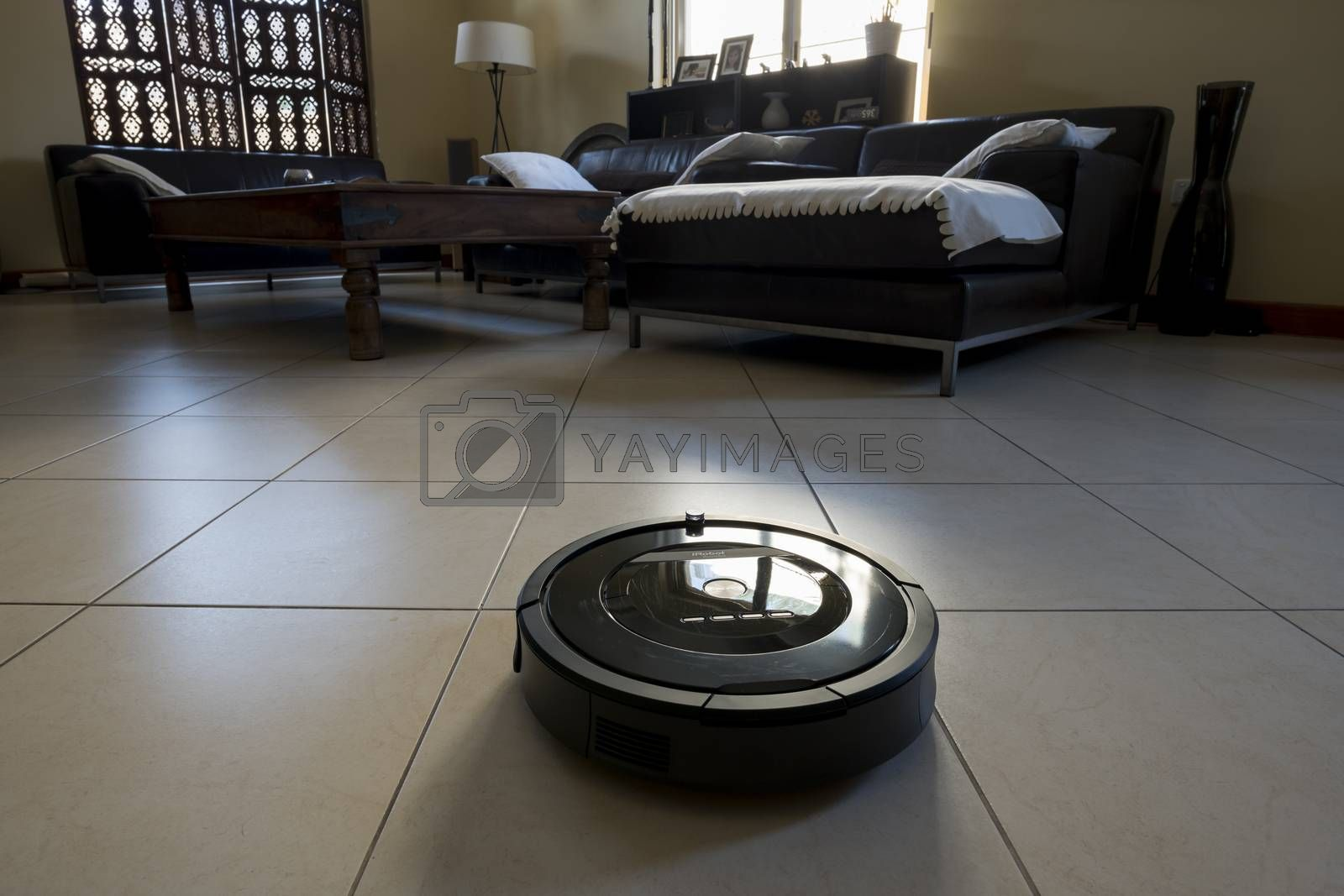 Royalty free image of Roomba iRobot vaccum cleaner in a saloon by GABIS