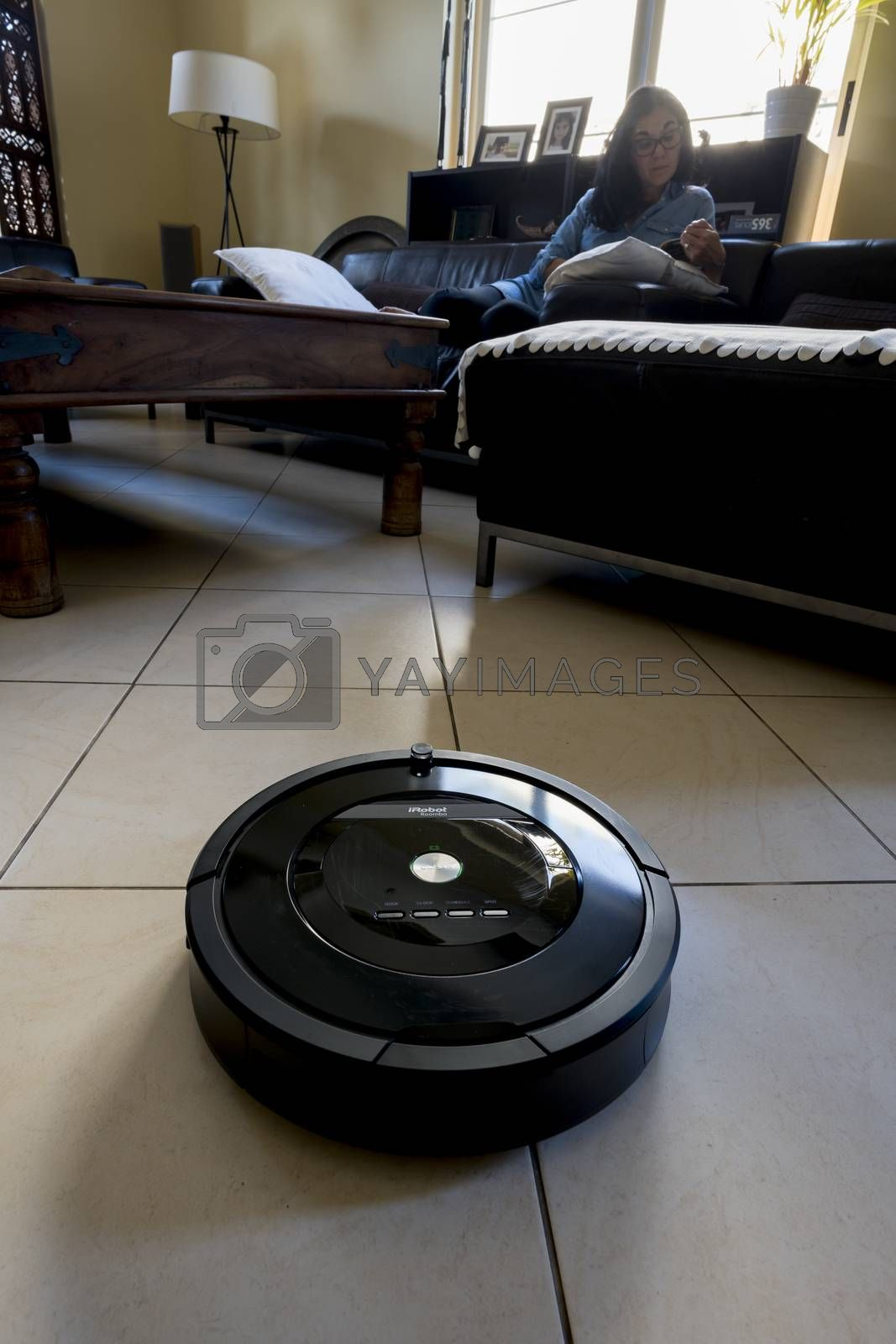 Roomba iRobot vaccum cleaner in a saloon by GABIS