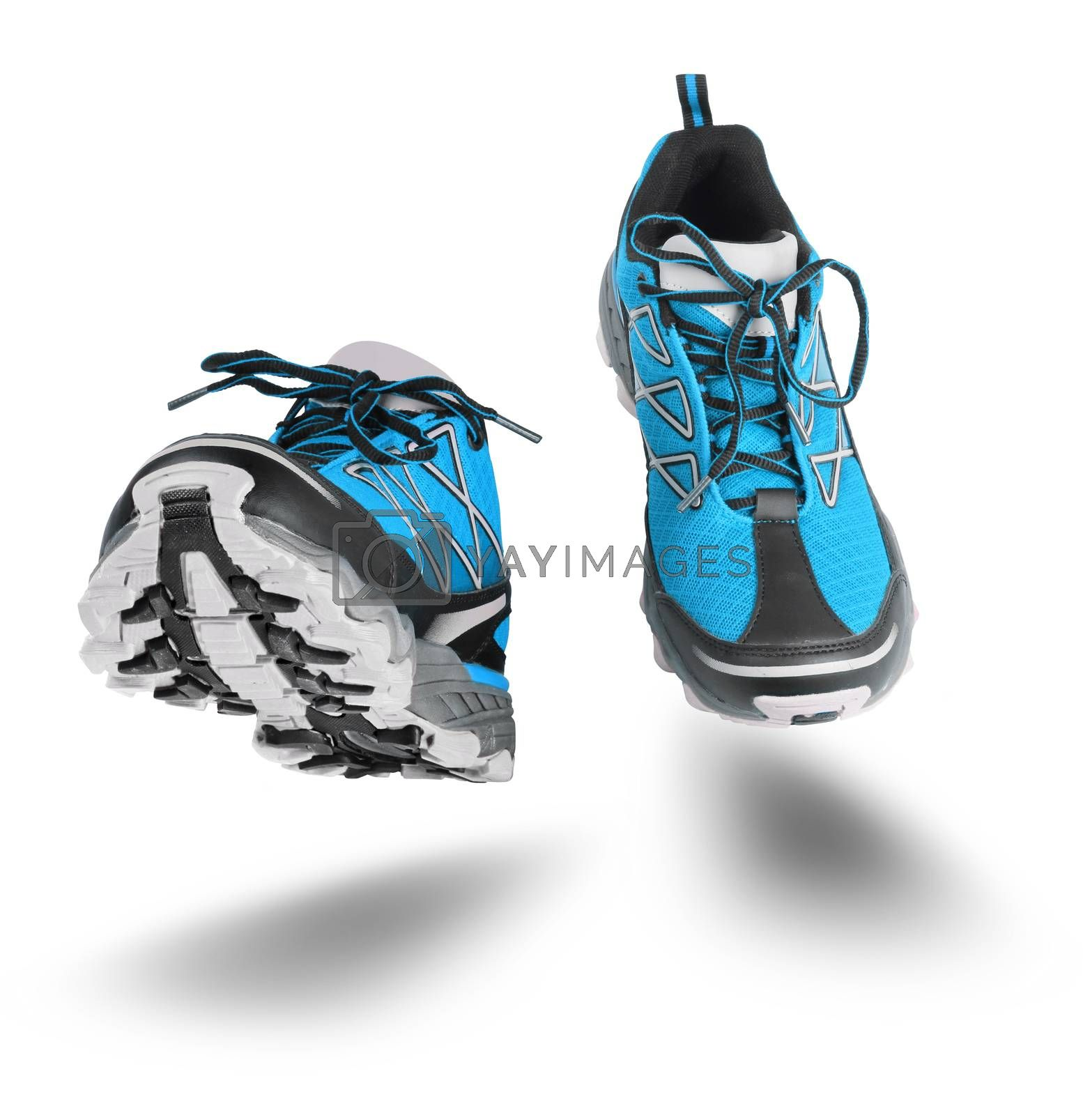 Running blue sport shoes seen front, isolated on white background