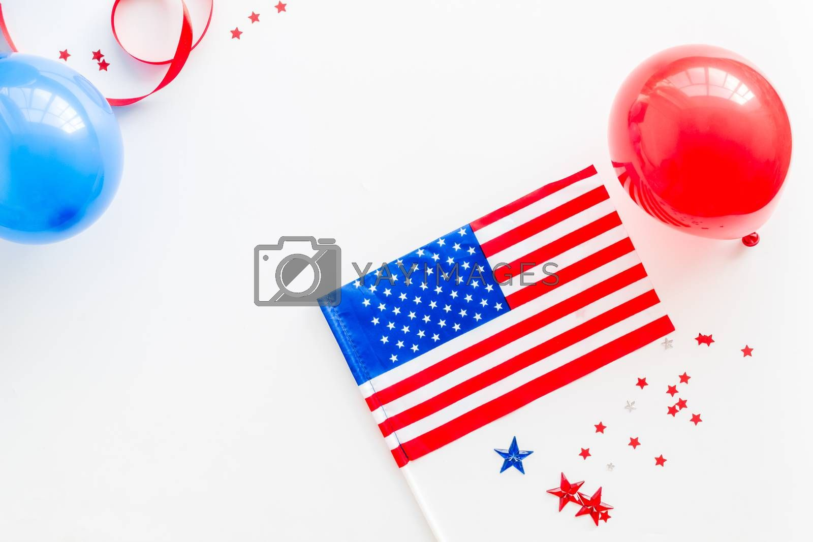 Royalty free image of 4th July greeting card with American flag and balloons flat lay copy space by 9dreamstudio