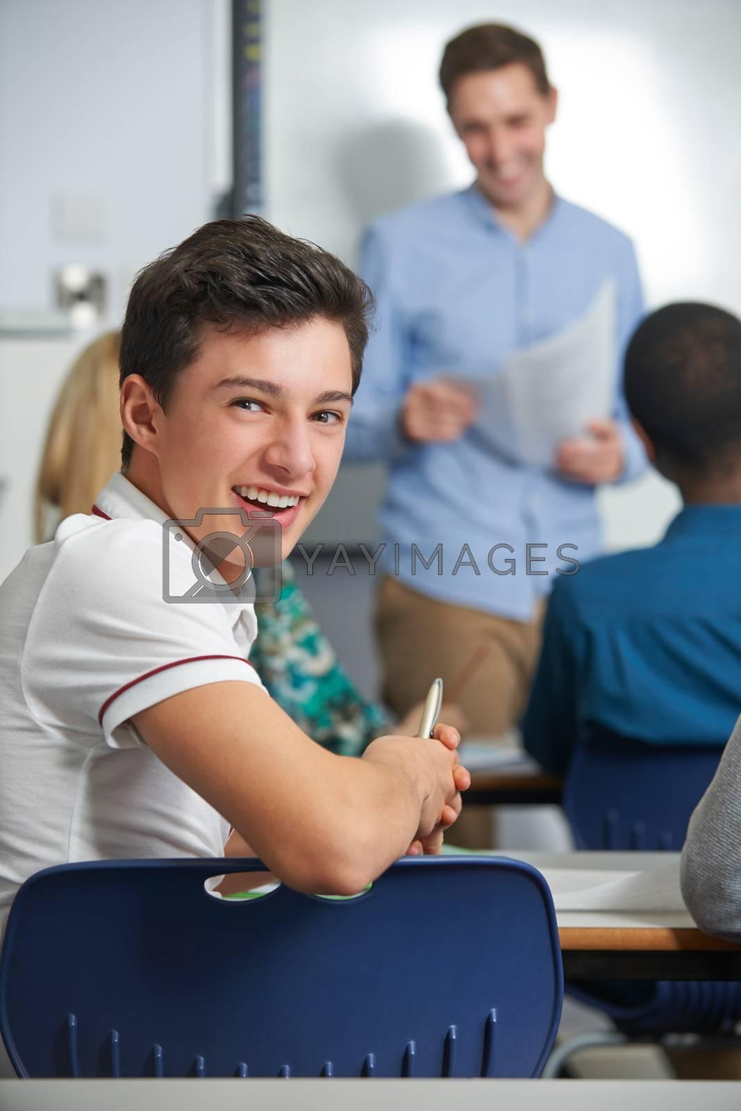 Portrait Of Male Teenage Pupil In Class