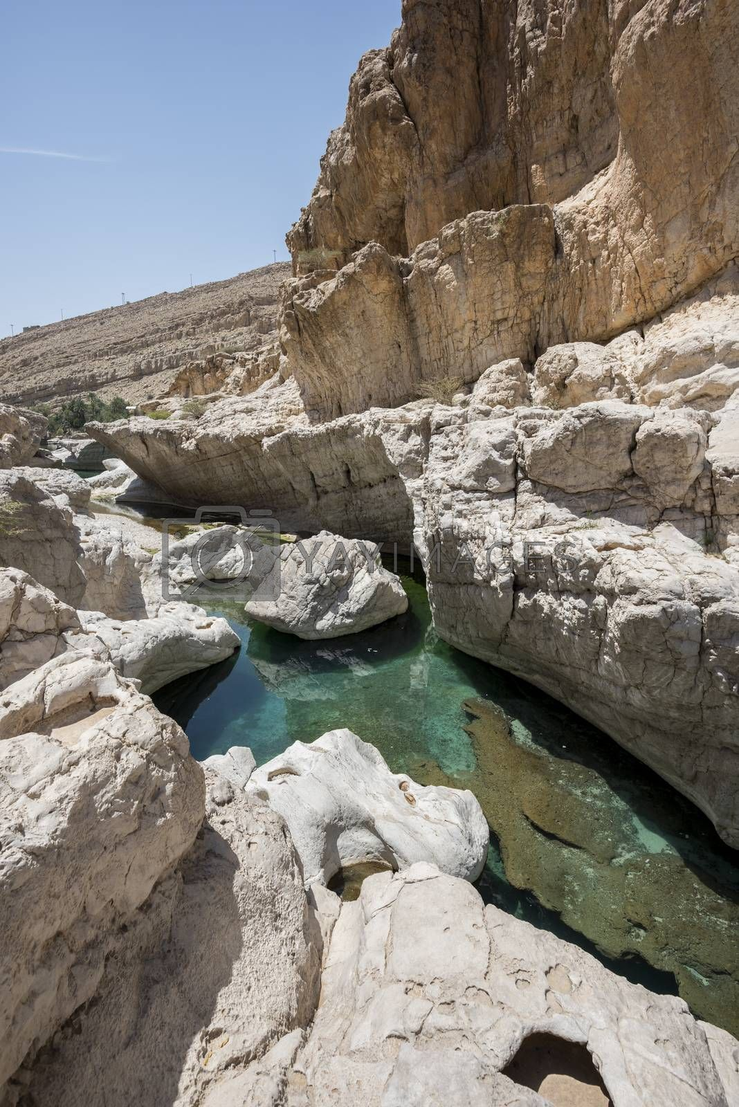 River (with turquoise water) and pool in the canyon of Wadi Bani Khalid, Oman