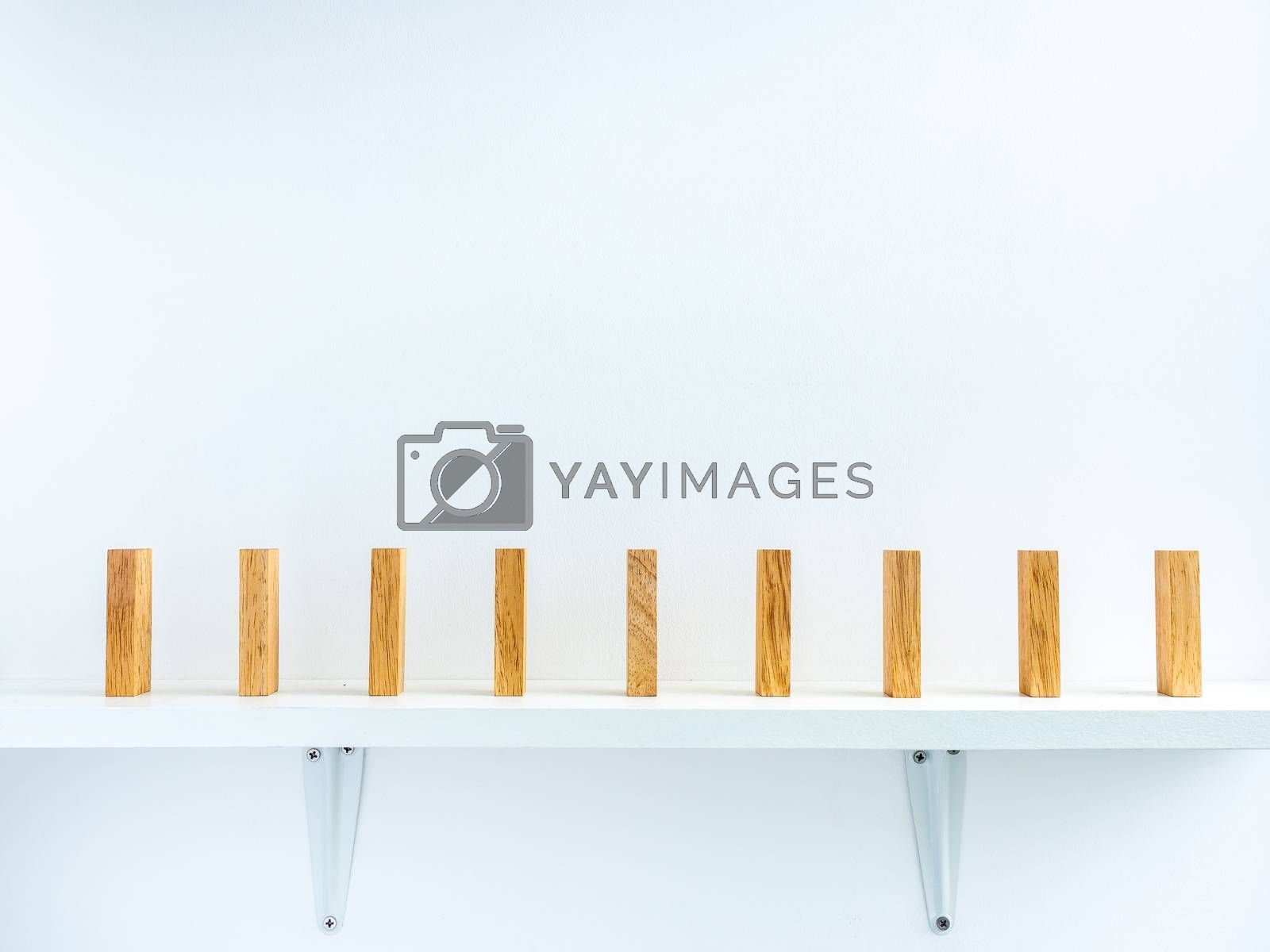 Social Distancing concept. Row of wooden dominoes with distance space on shelf on white background.
