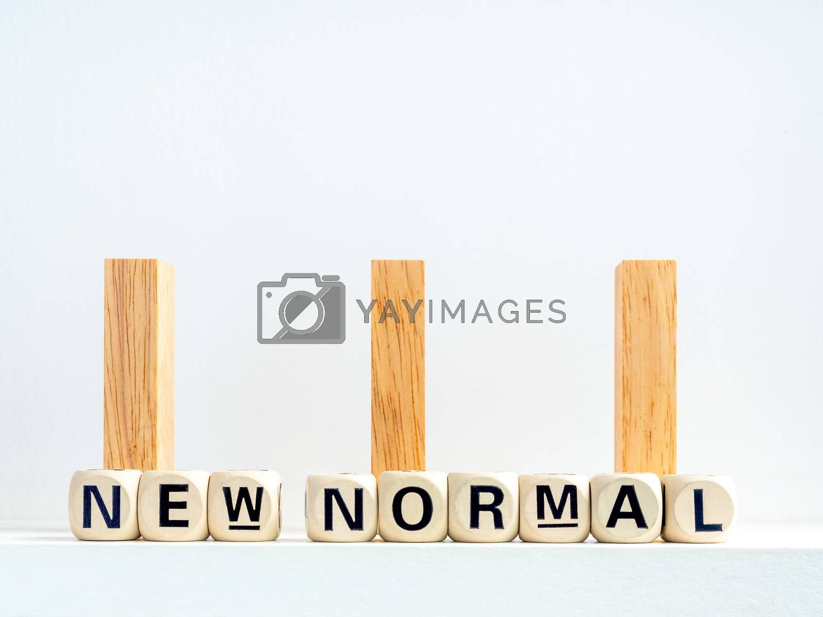 Social Distancing concept. Row of wooden dominoes with distance space and New Normal, words on wooden alphabet cube on white background.
