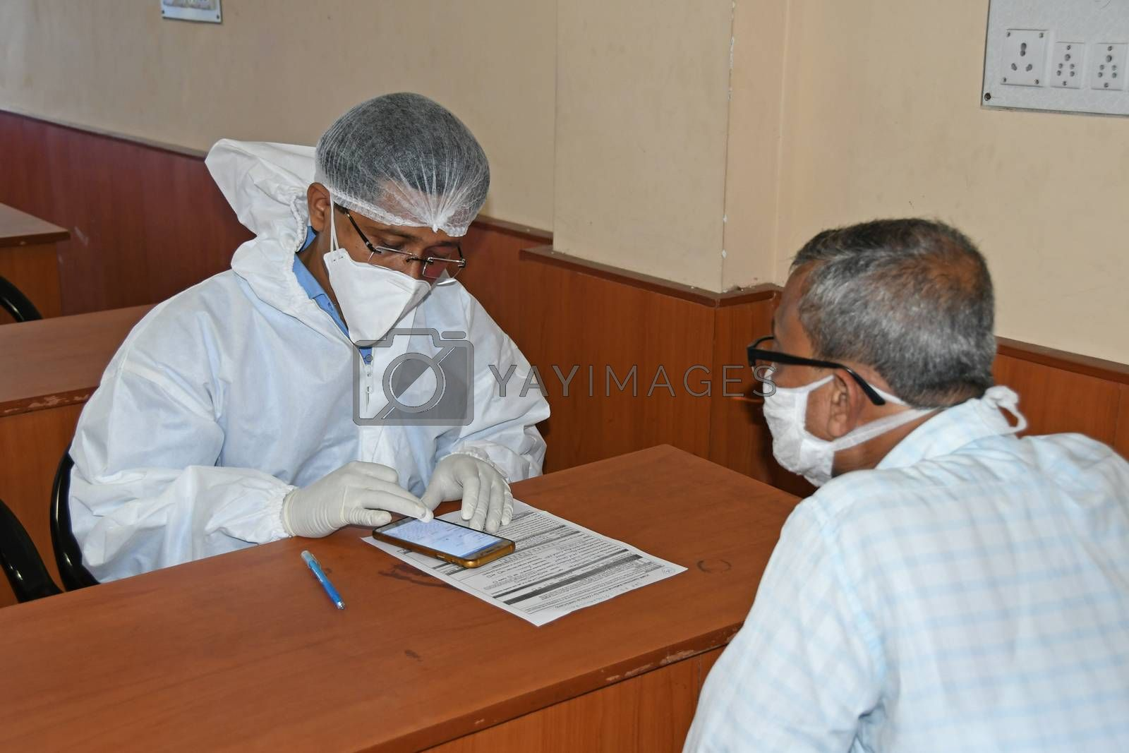 Burdwan Town, Purba Bardhaman District, West Bengal / India - 24.06.2020: Health workers are collecting samples of asymptomatic journalist for COVID-19 (Novel Coronavirus) test in the initiative of Purba Bardhaman District Health Department.