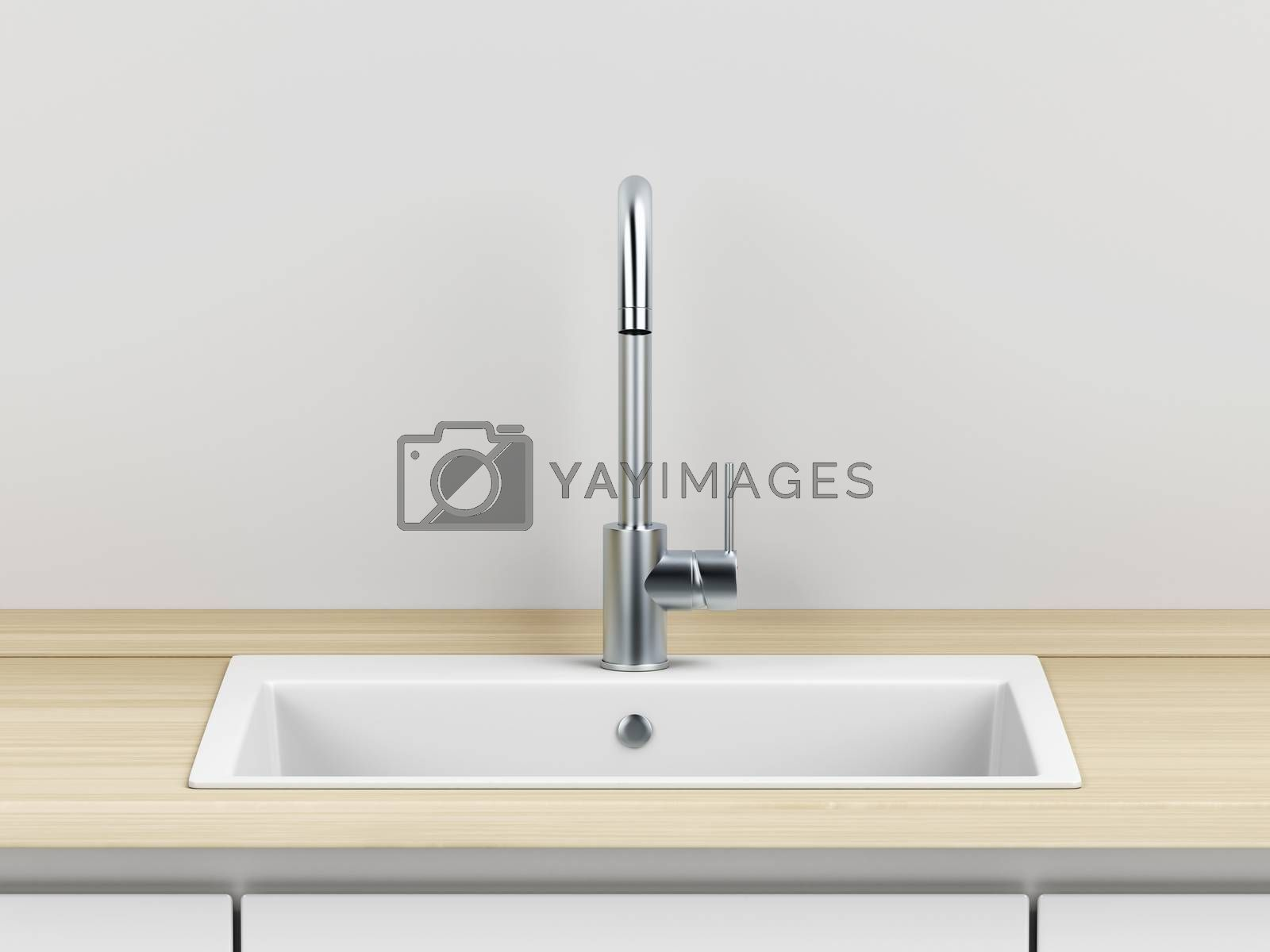 Modern silver faucet and white composite sink in the kitchen