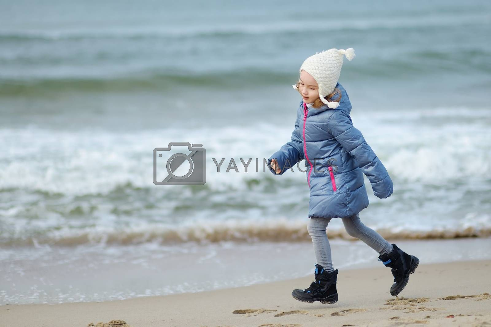 Adorable little girl playing by the ocean by maximkabb