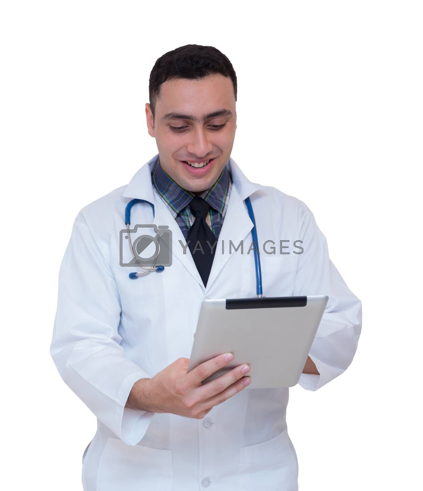 Doctor holding a tablet computer while using it isolated on white background