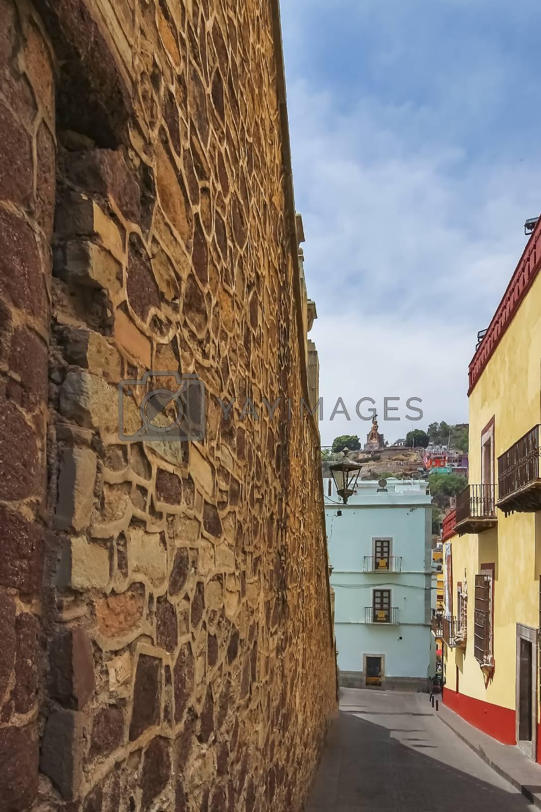 Brick wall at the side of the steps of the University of Guanajuato along Subida de Los Hospitales street