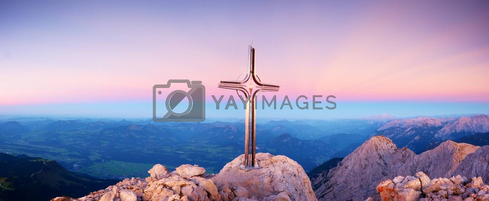 Hoher Goell autumn daybreak panorama. Iron cross at mountain top in Alp at Austria Germany border.  View to Tennen Range and Dachstein range, Berchtesgaden Alps.