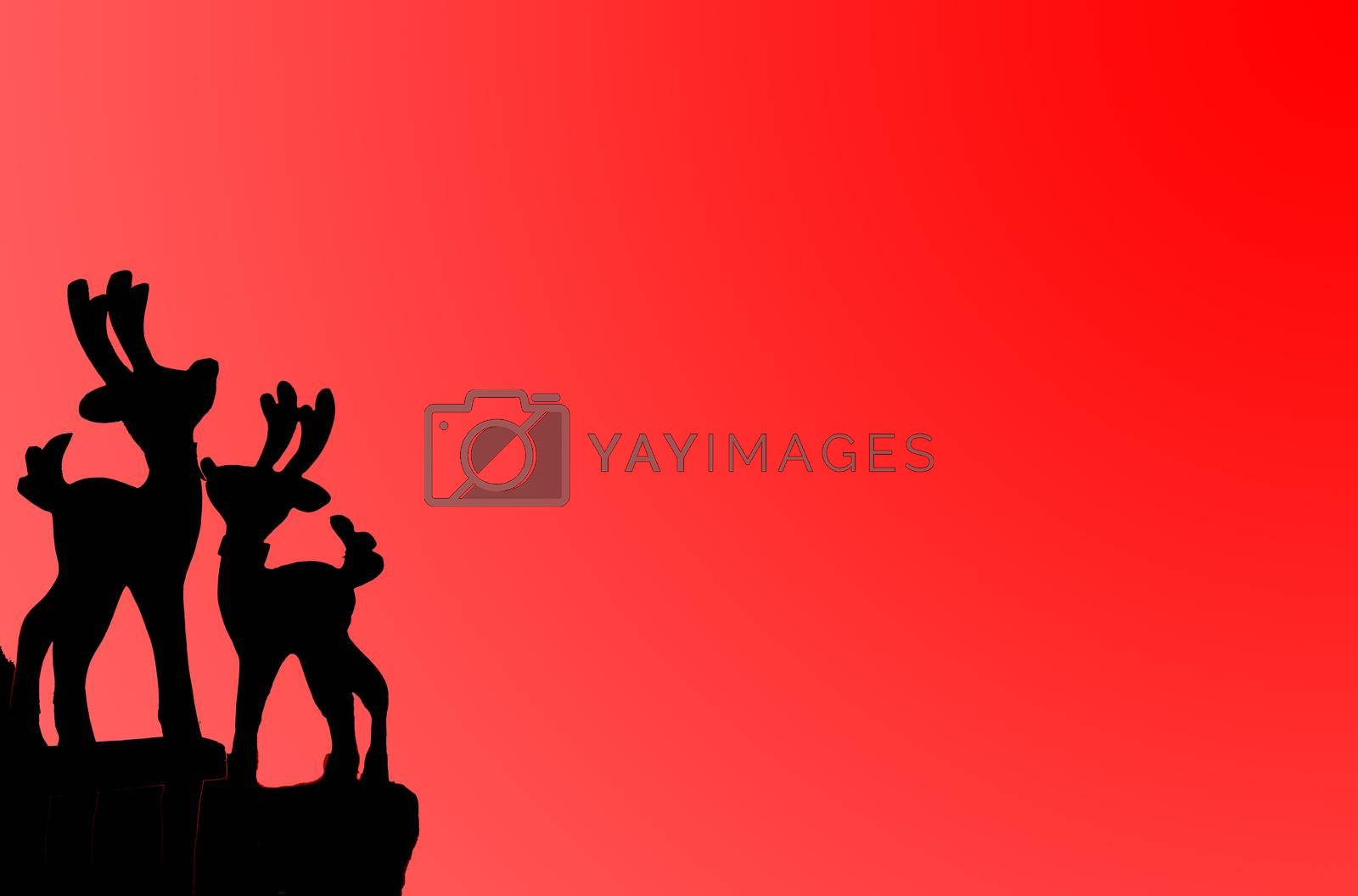 christmas card with rudolph on red background with copy space