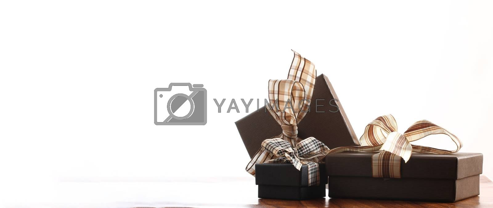 brown christmas present with ribbon. Presents in a table with decoration and copy space and a ribbon