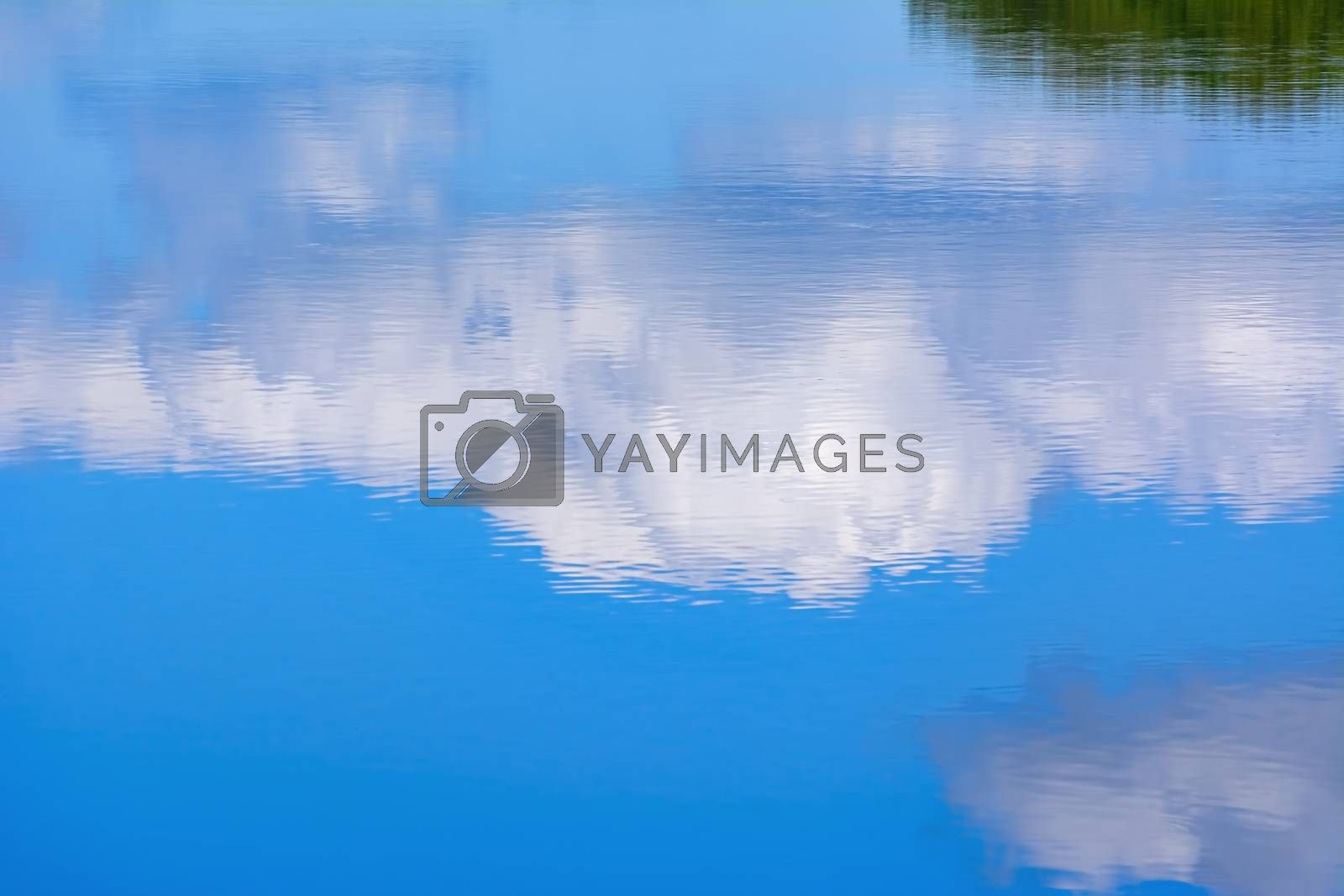 Reflection of the cloud in the lake