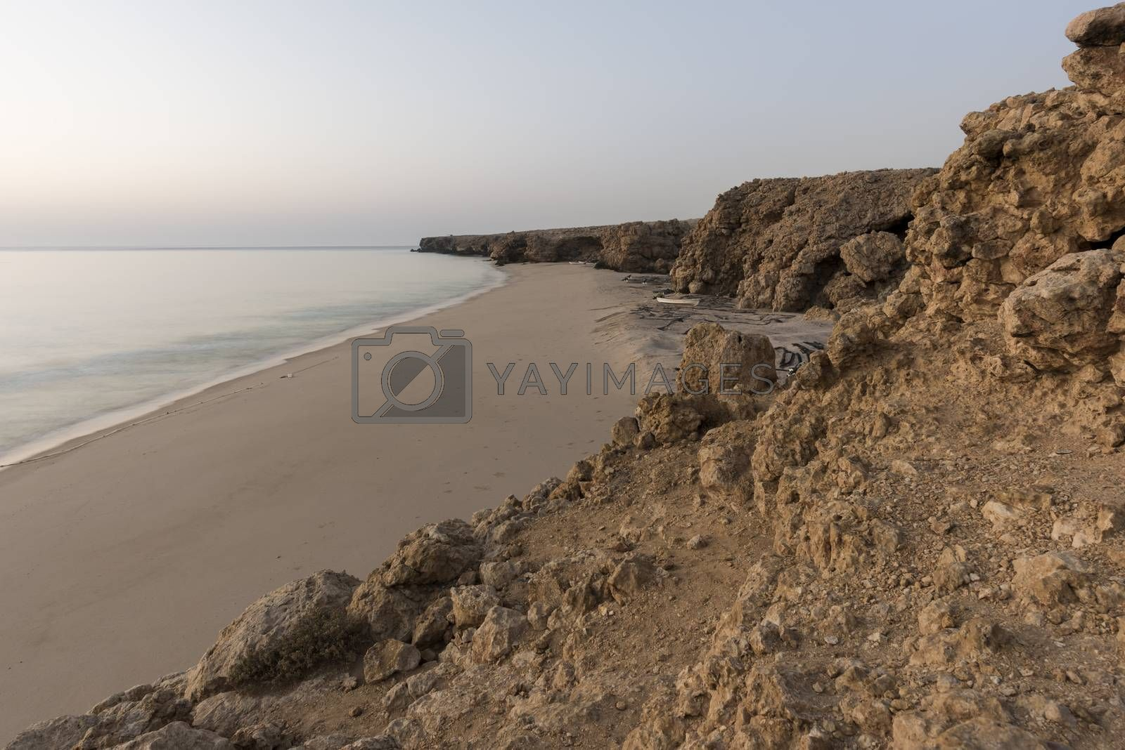 Wild beach at the coat of Ras Al Jinz, Sultanate of Oman. It is a place for fishermen to put their boats and repair their nets.