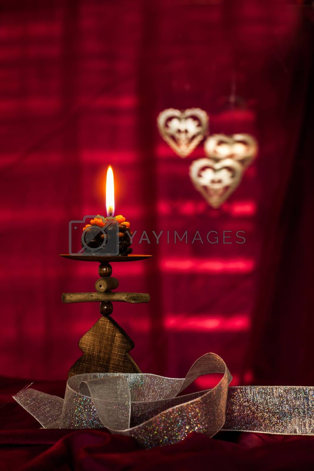 Christmas concept with red background and candles