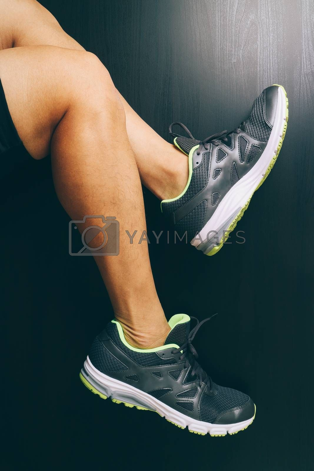 Runner sportsman holding ankle in pain with Broken twisted joint running sport injury and Athletic man touching foot due to sprain on dark background