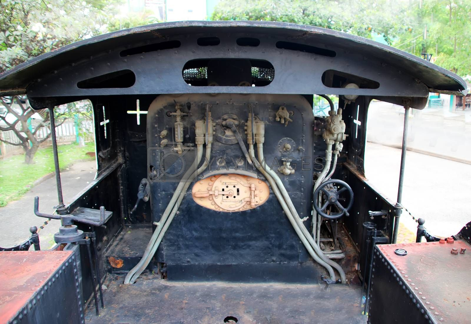 Engineer booth of an old black steam train, Cambodia