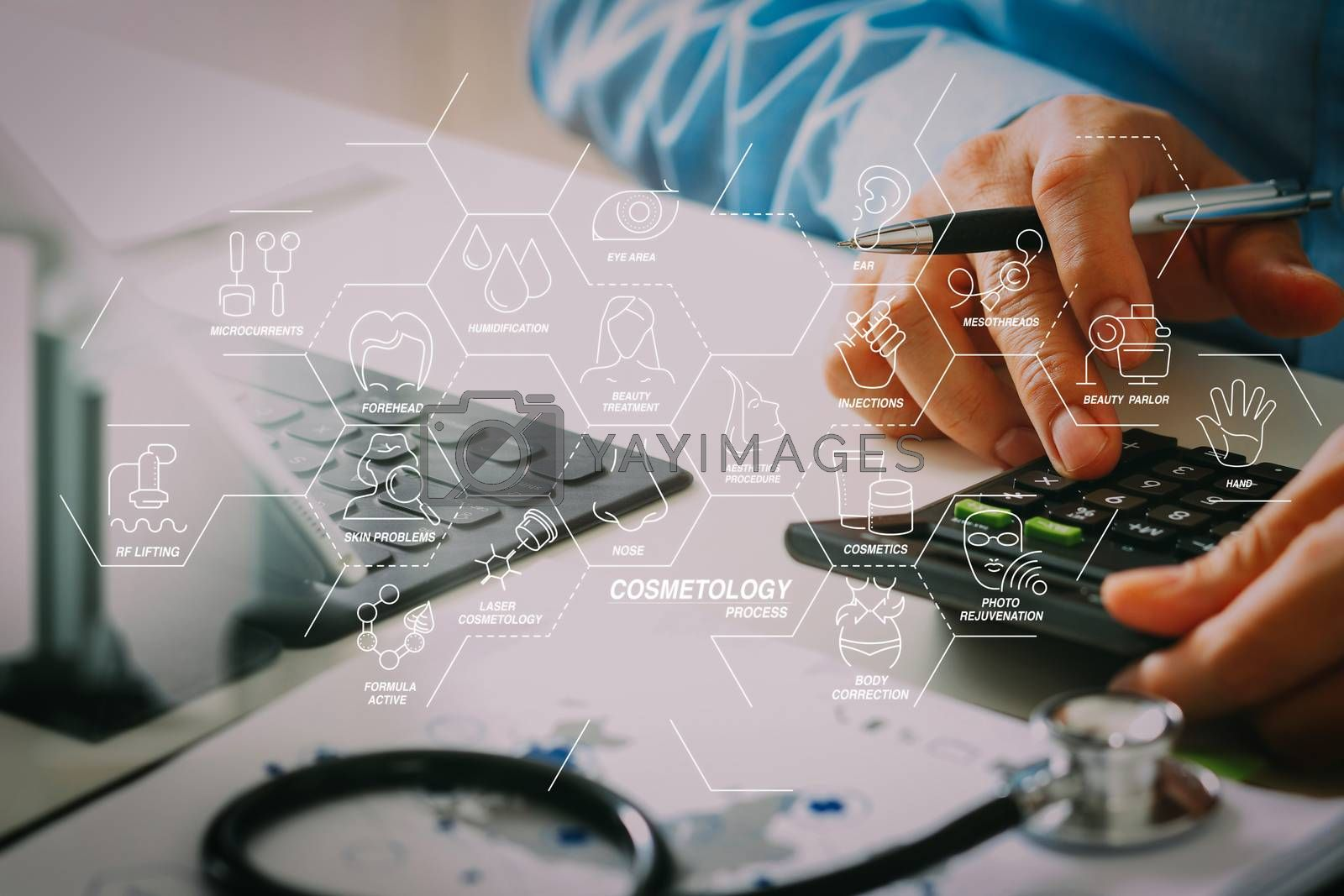 Royalty free image of Healthcare costs and fees concept.Hand of smart doctor used a ca by everythingpossible