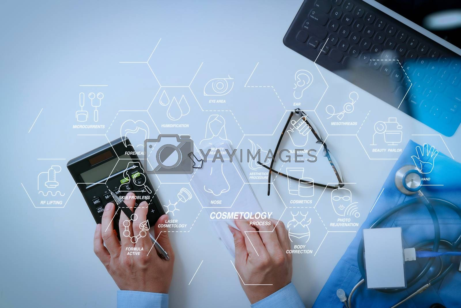 Royalty free image of top view of Healthcare costs and fees concept.Hand of smart doct by everythingpossible