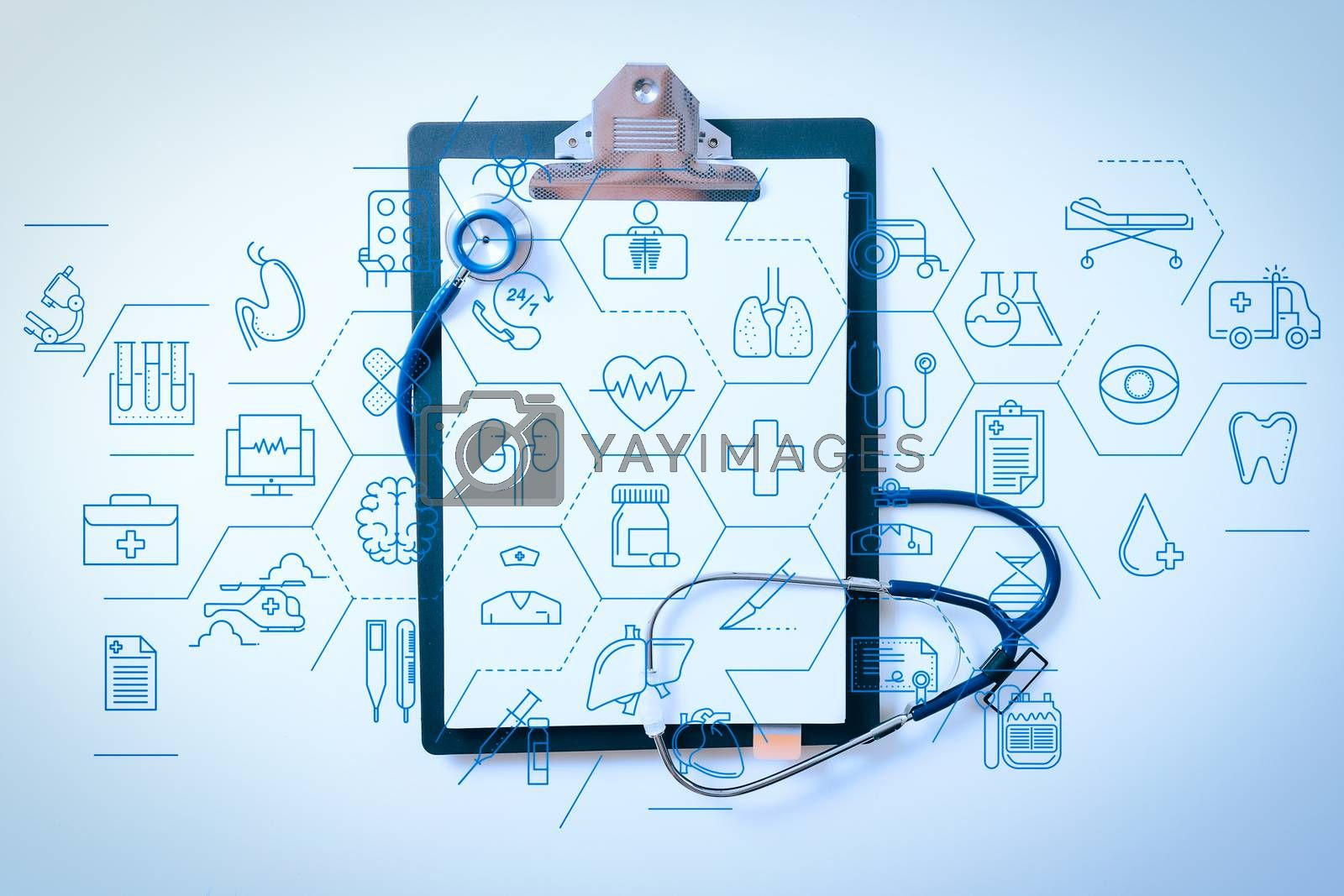 Royalty free image of blank stethoscope and gray clipboard on white desk background by everythingpossible