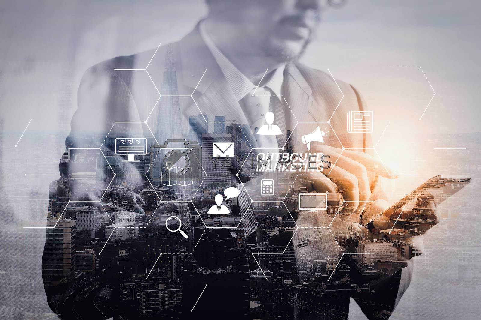 Royalty free image of Double exposure of success businessman using smart phone with Lo by everythingpossible