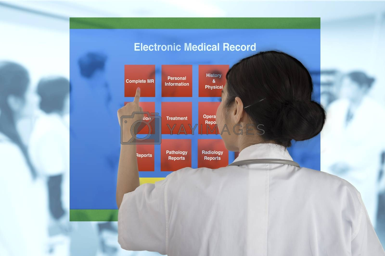 Female doctor pointing to choose working item from electronic medical record menu with blur background of doctor meeting.