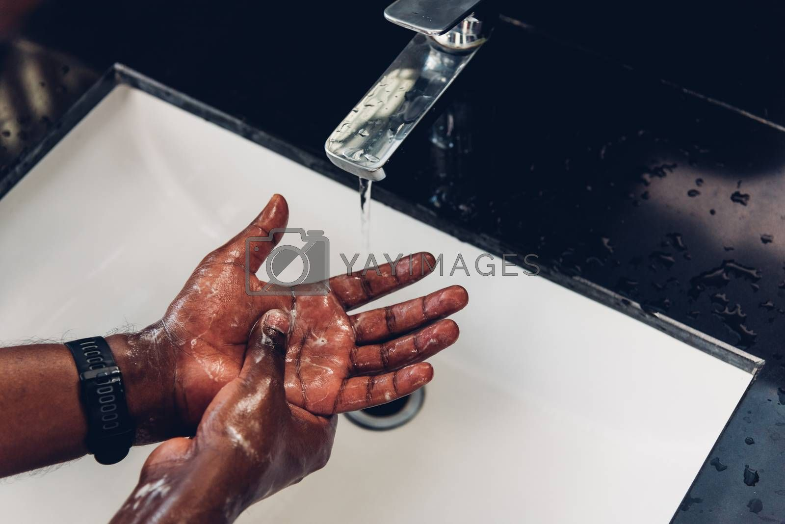 Closeup washing black man hands rubbing with soap and water in sinks to prevent outbreak coronavirus hygiene to stop spreading virus, hygiene for quarantine cleaning COVID-19 concept