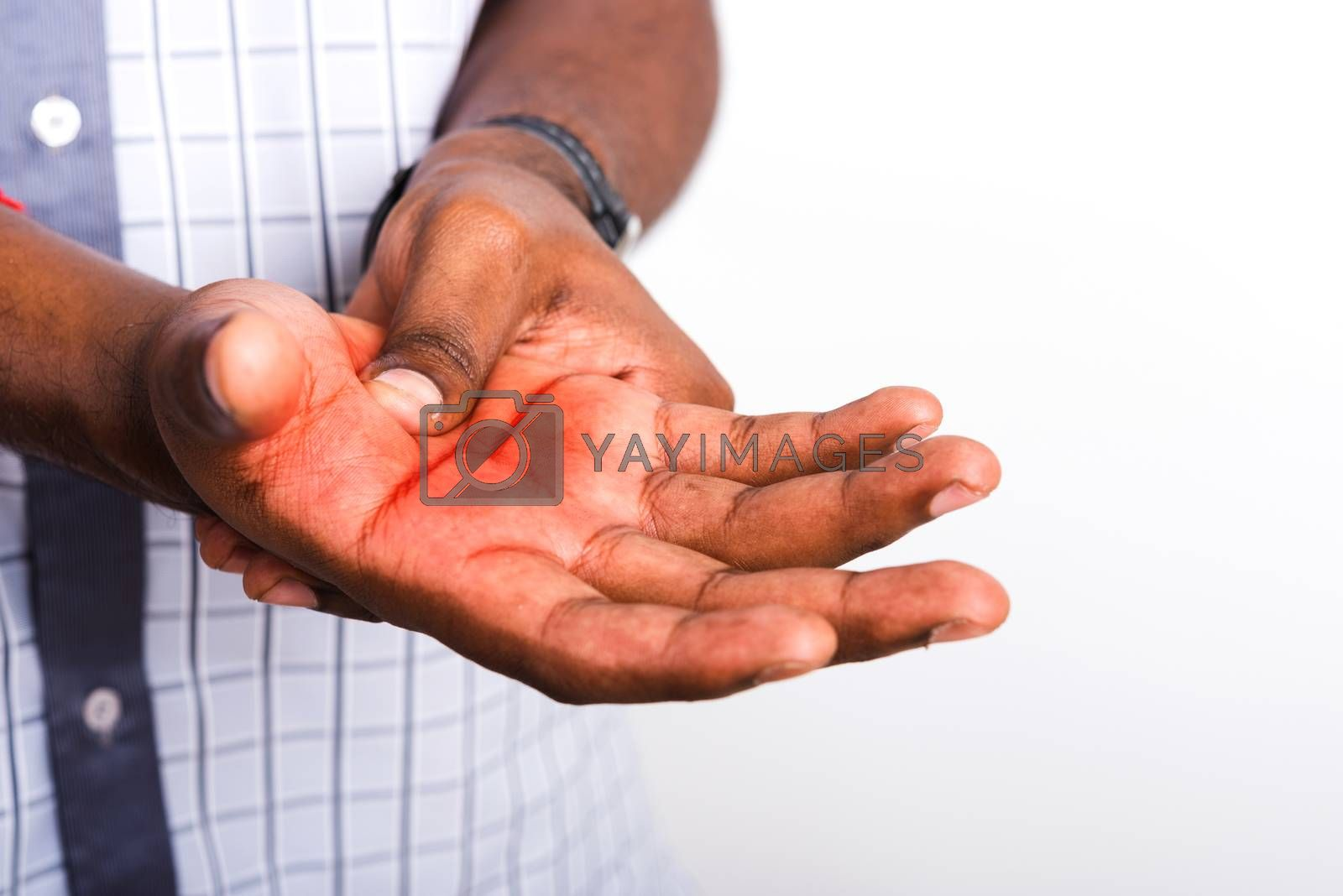 Closeup hand Asian black man holds his palm hand injury, feeling pain, studio shot isolated on white background. Health care and medical office syndrome concept